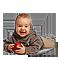 Малыш с красной игрушкой